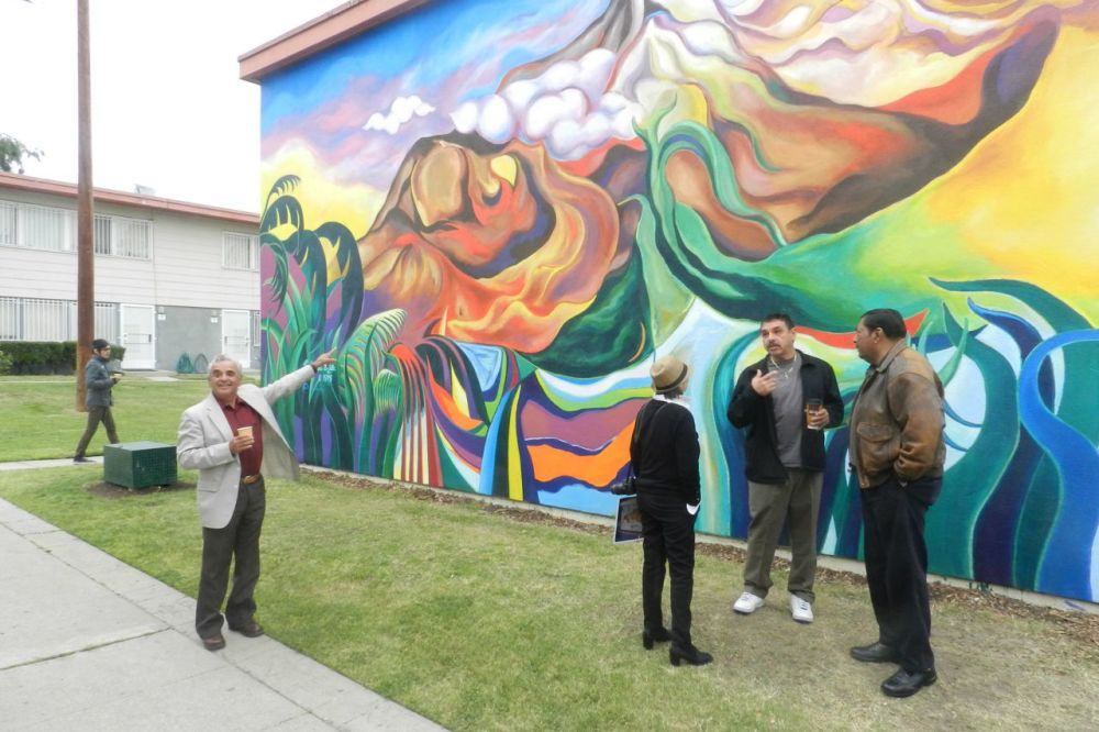 Estrada Courts mural restored in an effort to preserve public art