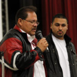 Aguilar's father speaking on their family's loss. Photo by Arturo Torres.