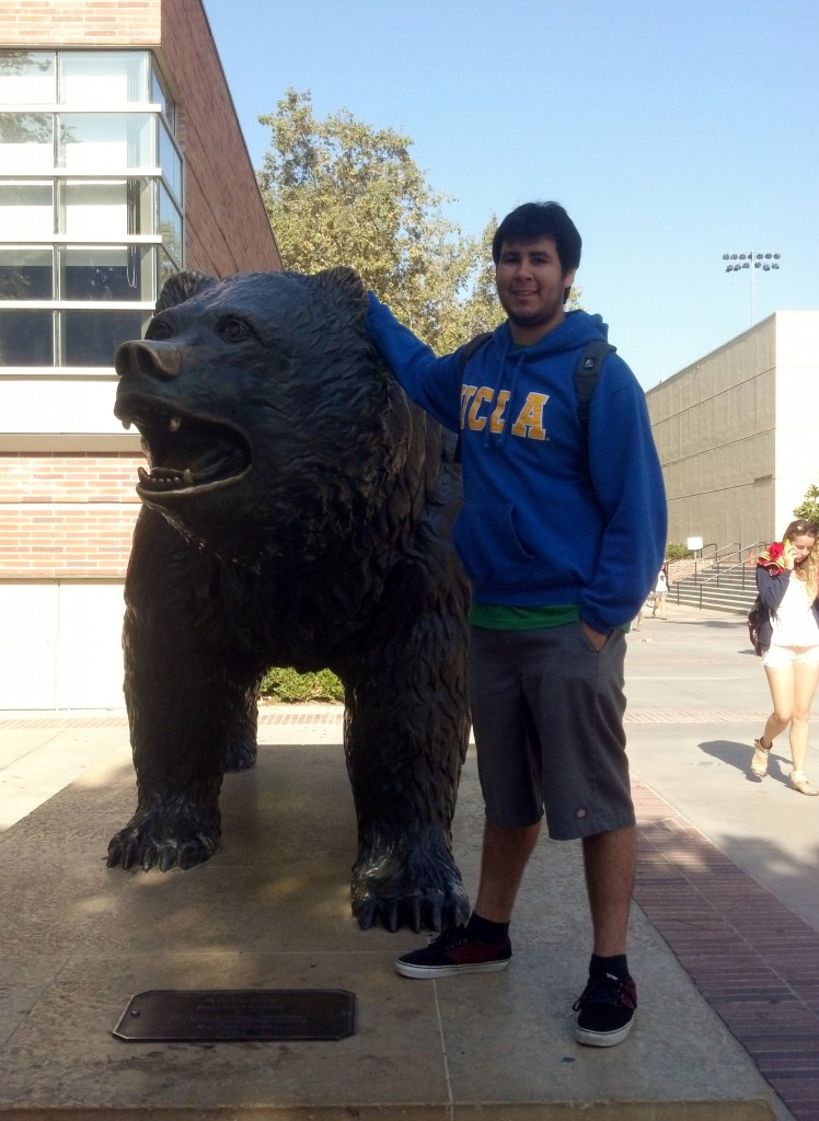 Emmanuel Bravo poses with  the Bruin statue at UCLA. / Photo courtesy of EMmanuel Bravo