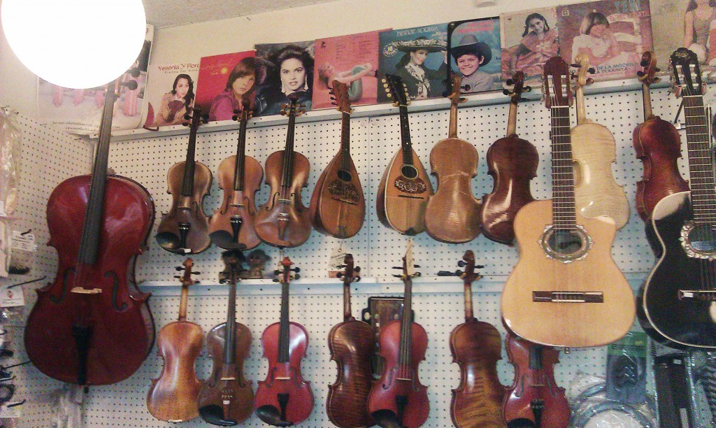 Los instrumentos cuelgan de las paredes de La Casa del Músico, una institución del vecindario desde 1979.  /Photo by Melissa Runnels