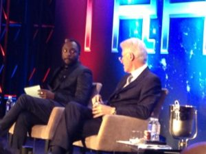 Former President Bill Clinton sits down with will.i.am at TRANS4M 2013. Photo by Kris Rivera