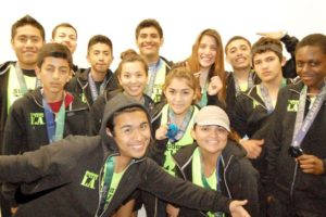 Sylvester, right, holding his medal with other students from Students Run LA. Photo courtesy of Sylvester Fooley