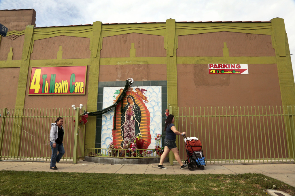 La Virgen de Guadalupe decorates the facade on a medical marijuana dispensary on 4th Street. Photo by Emily Ochoa