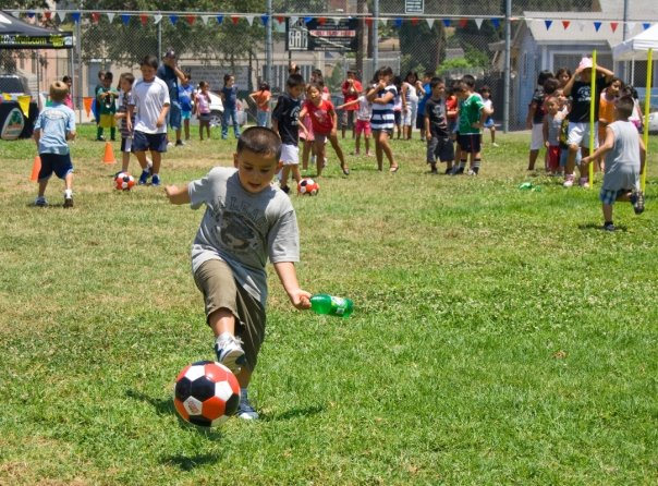 A boy places soccer. Credit: Art Torres.