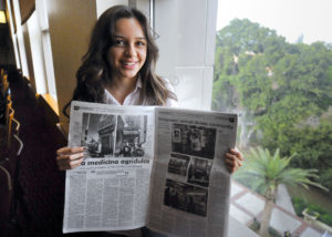 Former youth reporter Brizette Castellanos displays her first article in the Boyle Heights Beat. Photo by Gus Ruelas
