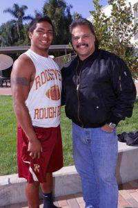 Arturo Campos (right) will watch his son, Chris Campos, play in the East L.A. Classic, as he once did as a Roosevelt Rough Rider. Photo by Art Torres