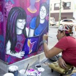 "Lilia ""Liliflor"" Ramirez paints a mural on First and Cummings streets."