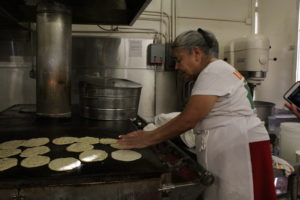 Marina Ayala has prepared tortillas and tamales at Los 5 Puntos for five decades.  Photo by Francisco Morales