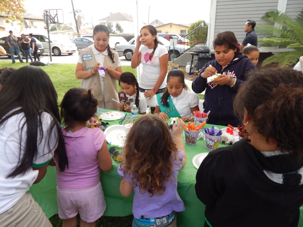 The Ramona Gardens Girl Scouts troop learn arts and crafts. Photo by Marcia Facundo