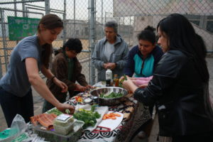 Participants of the workshop made their own communal salad. Photo by Lourdes Espinoza