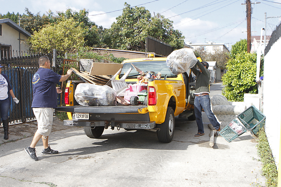 Community members collect bulky items as part of the Boyle Heights Community Clean Up. Photo by Arturo Torres