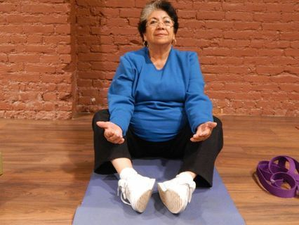 Maria Delgado, 68, says she feels more relaxed after taking yoga classes. Photo by David Galindo.