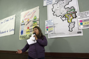 Maria Ruiz speaks to a crowd of over 100 people. Photo by Jonathan Olivares.