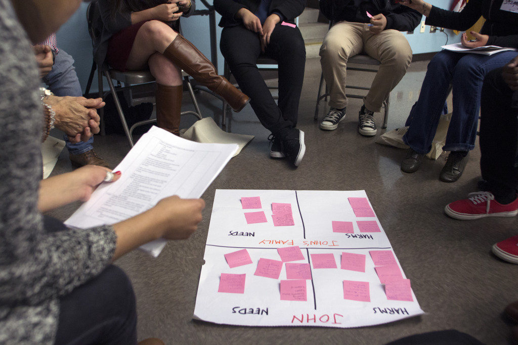 Participants join a circle to discuss restorative justice. Photo by Jonathan Olivares