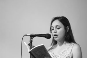 "Roosevelt student Brizette Castellanos read an excerpt from ""If I Knew Then What I Know Now."" Photo by Shireen Alihaji."
