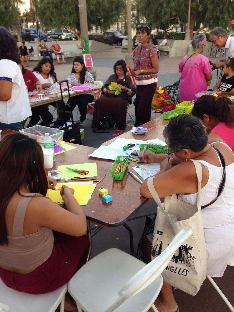 """Residents participate in workshops at """"ActivARTE: Detouring Displacement."""" Photo from Facebook/Legacy LA."""