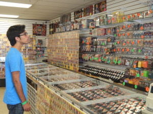 A customer carefully makes a selection at Savy's in Boyle Heights. Photo by David Galindo.