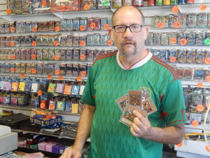 Jaime Rovero, 45, who manages Savy's, says, Yu-Gi-Oh cards are the most popular. Photo by David Galindo.