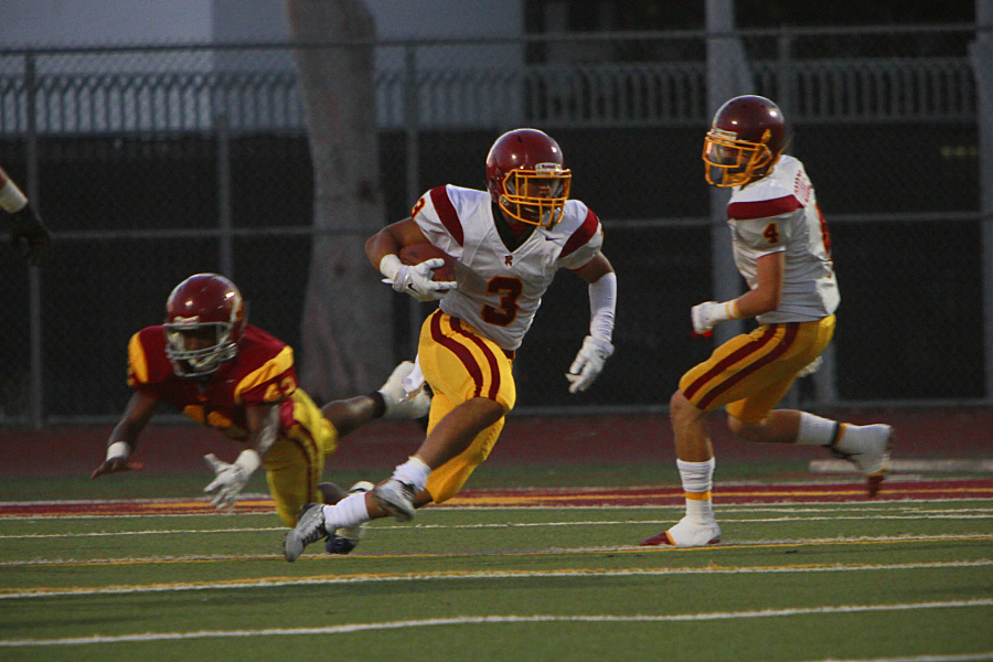 Running back Ignacio Vasquez scores a great run to give Roosevelt High School the victory over Fairfax High School 31 to 13. Photo by Art Torres