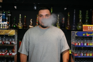Rodolfo Bolivar, who works at his family's smoke shop, says vaping has become very popular. Photo by Brizette Castellanos.