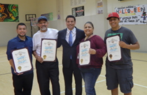 Former members of the Ramona Gardens Residents Advisory Council receive a recognition award from City Councilman Jose Huizar. Photo by Antonio Mejias- Rentas