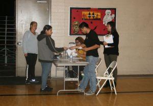 Ramona Gardens residents cast their vote. Photo by Antonio Mejias Rentas