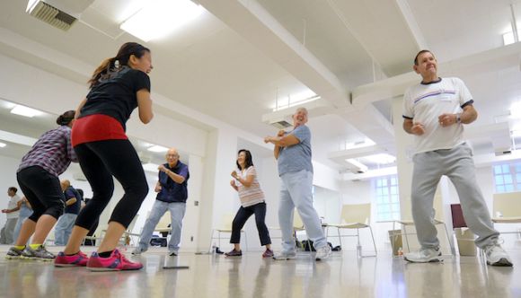 Workout instructors lead Kenneth Yokoyama, Pauline Beavers, Barbara Counsil and Richard Counsil, from left, through their exercise class. (USC Photo/Gus Ruelas)