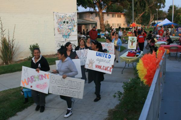 Ramona Gardens residents honor the dead, dedicate peace march to Mexico's 43 missing students