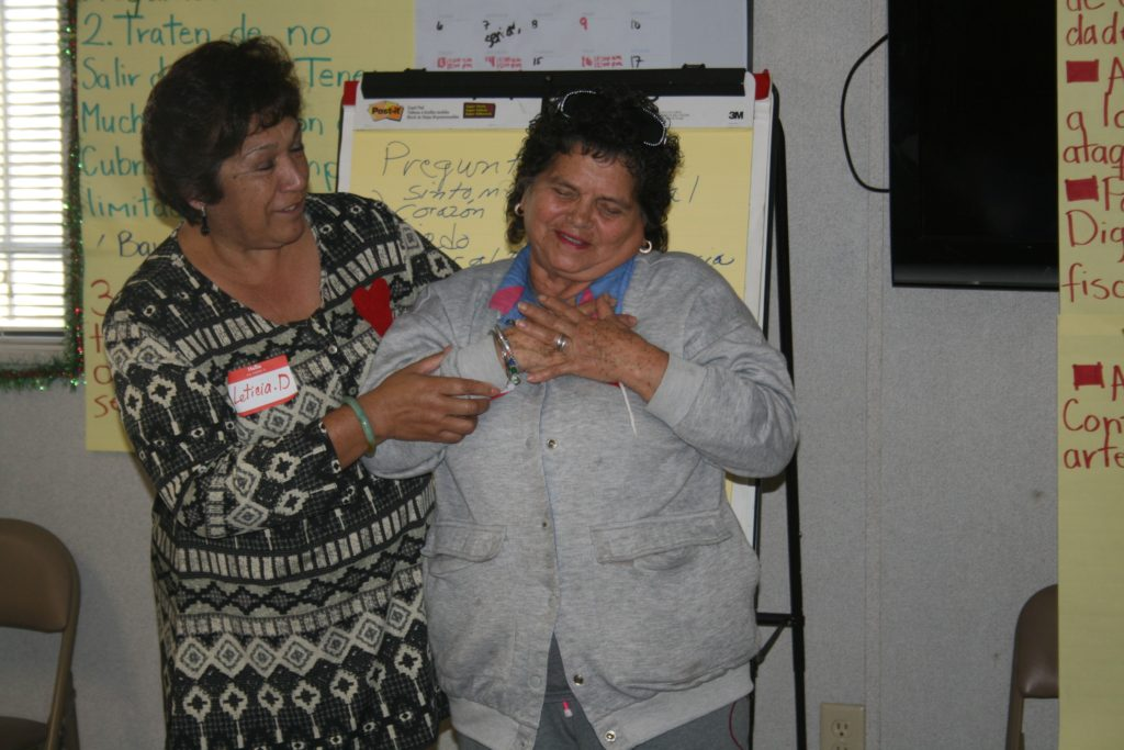 Members of the Ramona Gardens seniors club reenact the symptoms of a heart attack during a heart health class Photo by Antonio Mekias
