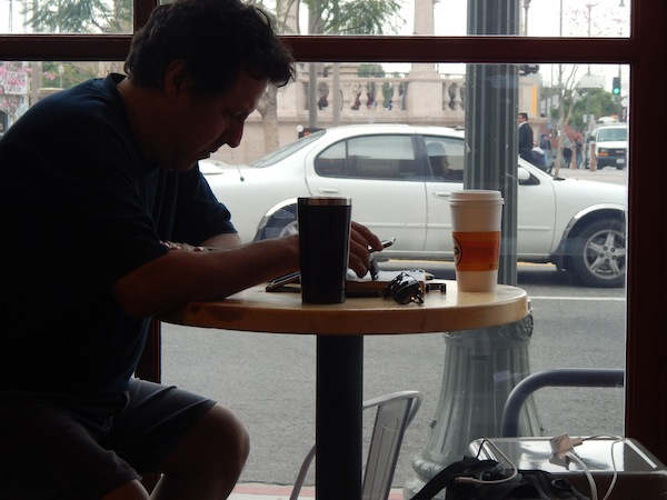 A customer logs in on his iPad using the free WIi-Fi service at La Monarca Bakery. Photo by Samantha Olmos.