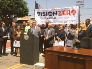 Mayor Garcetti adresses the crowd gathered at the corner of César Chávez and St. Louis. PHOTO: City of Los Angeles