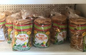Tostadas line up the shelf at San Marcos, which sells its many products to area restaurants. Photos by Rony Contreras.