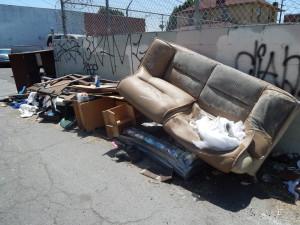 Trash pickup said to be slower in poor neighborhoods