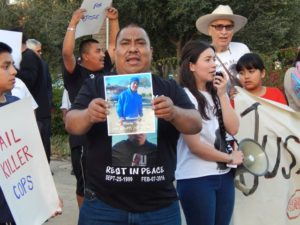 Juan Méndez shows a picture of his son José Méndez, who was killed in an officer-involved shooting on Feb. 6, 2016.