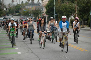 For the second time since last year, Eastside Mural Ride organized hundreds of bicyclists on a tour of the murals of Boyle Heights and East Los Angeles. Photo by Erik Sarni