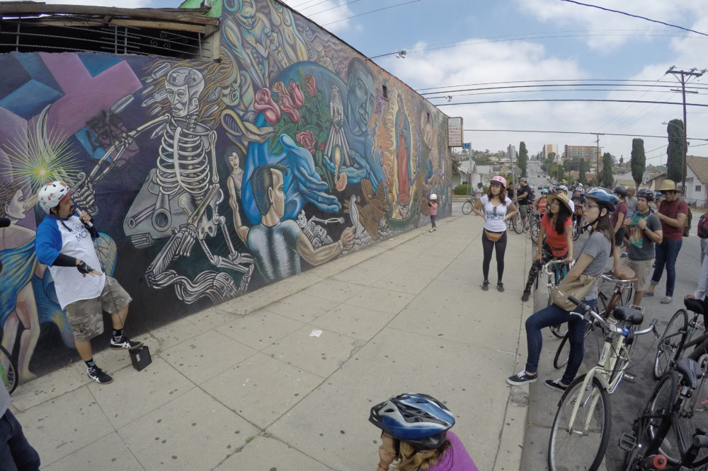 Bicyclists highlight the murals and history of the eastside