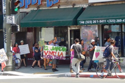 Dozens march and rally in support of Proyecto Jardín